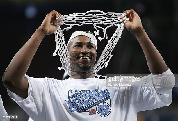 Jawad Williams of the North Carolina Tar Heels celebrates with one of the nets after defeating the Illinois Fighting Illini 75-70 during the NCAA...