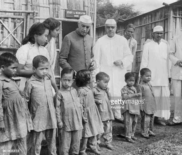 Jawaharlal Nehru Prime Minister of India visits children at the leper colony at Pasighat Assam with Jairamdas Daulatram Governor of Assam 27th...