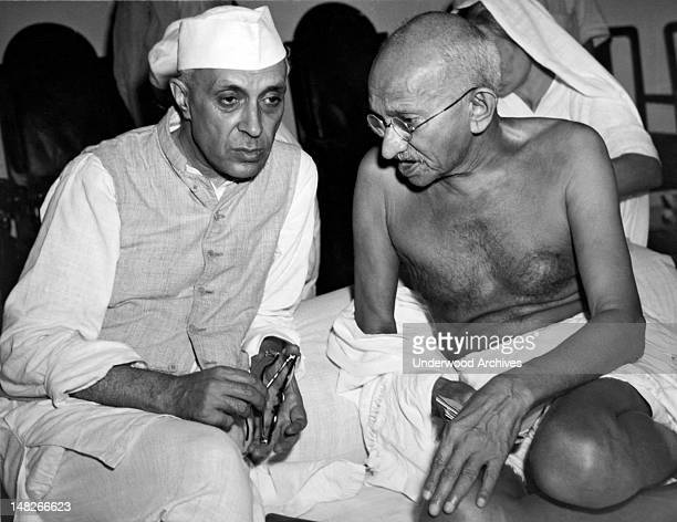 jawaharlal Nehru the newly elected President of the All India Congress talking with Mahatma Gandhi Indian political strong man at a meeting of the...