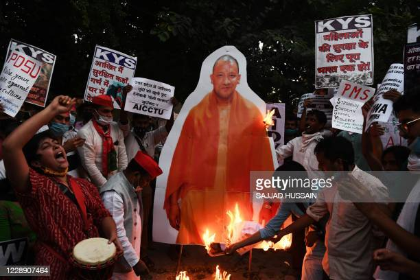 Jawaharlal Nehru University students along with other demonstrators burn a cut-out of Chief Minister of Uttar Pradesh Yogi Adityanath during a...