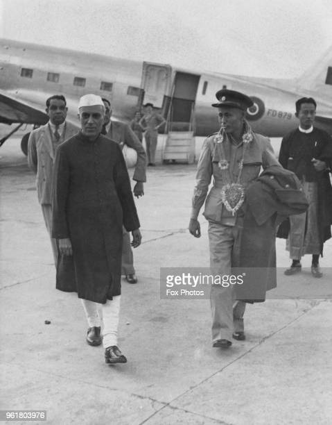 Jawaharlal Nehru Vice President of the Executive Council of India and Aung San Premier of Burma leave the airport in Delhi January 1947 Aung San is...