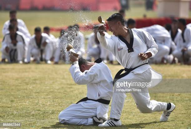Jawan displays stunt of breaking coconut during the celebration of 257th Corps Day of Army Service Corps at Agram ground on December 9 2017 in...