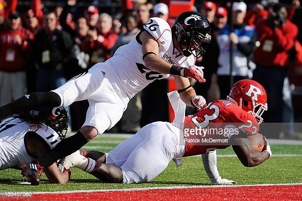 Jawan Jamison of the Rutgers Scarlet Knights scores a touchdown against the Cincinnati Bearcats at Rutgers Stadium on November 19, 2011 in New...