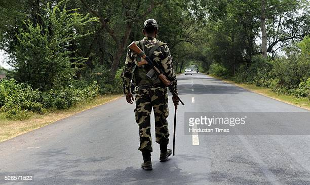 CRPF jawan stands guard during the fifth phase of West Bengal Assembly elections on April 30 2016 in Kolkata India Over 78% of the electorate cast...