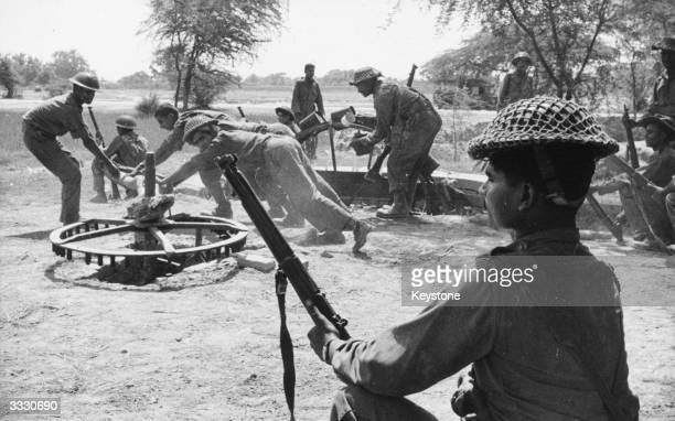 Jawans drawing fresh water from a Rehet, a water wheel, near Dera Baba Nanek, on the front line of the India-Pakistan conflict.