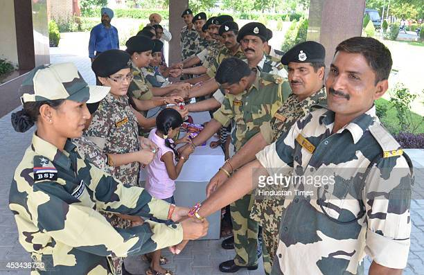 Jawans male and female sharing Rakhi's and sweets with each other and celebrating on the occasion of Raksha Bandhan at Khassa on August 10 2014 in...