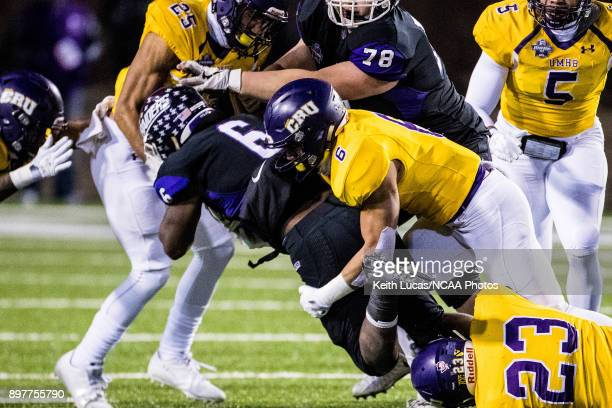 Jawanza EvansMorris of the University of Mount Union is tackled by Santos Villarreal III of the University of Mary HardinBaylor during the Division...
