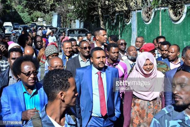 Jawar Mohammed a member of the Oromo ethnic group who has been a public critic of Abiy walks among his supporters that had gathered outside his home...