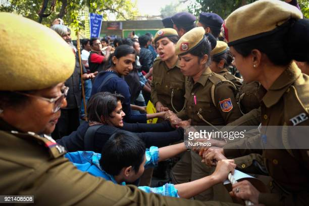 Jawarharlal Nehru University students push against Delhi police officials as they stop their march towards Ministry of Human Resource Development in...
