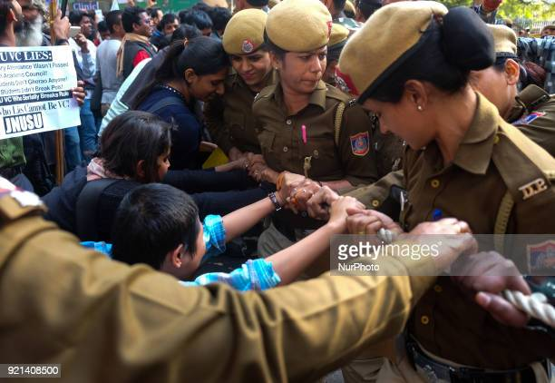 Jawarharlal Nehru University students push against ropes laid by Delhi Police officials to stop the march towards Ministry of Human Resource...