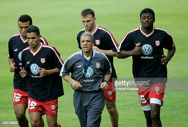 Jawhar Mnari Anis Ayari Karim Essedri and Radhi Jaidi run during the Tunisian National Team training session for the FIFA Confederations Cup 2005 on...