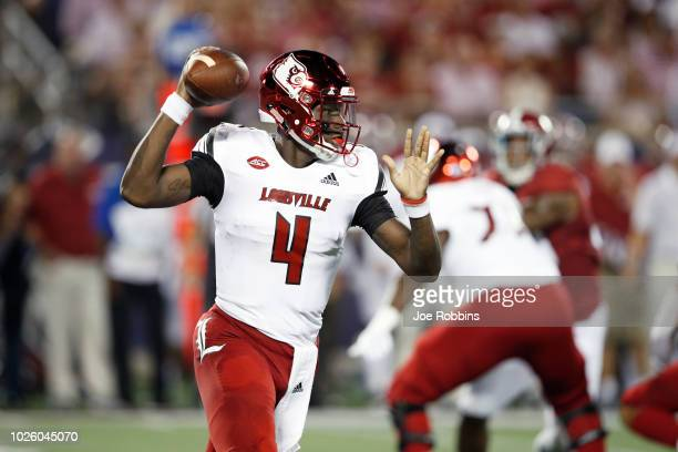 Jawon Pass of the Louisville Cardinals looks to pass in the first quarter of the game against the Alabama Crimson Tide at Camping World Stadium on...