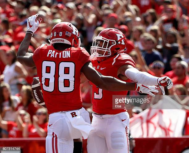 Jawuan Harris of the Rutgers Scarlet Knights celebrates his touchdown with teammate Andre Patton in the first half against the New Mexico Lobos at...