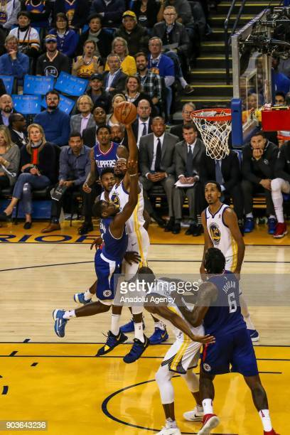 Jawun Evans of LA Clippers in action against Kevin Durant of Golden State Warriors during the NBA basketball game between LA Clippers and Golden...