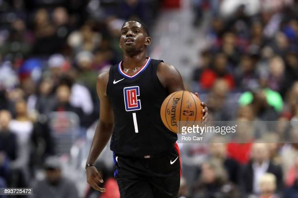 Jawun Evans of the LA Clippers dribbles the ball against the Washington Wizards in the first half at Capital One Arena on December 15 2017 in...