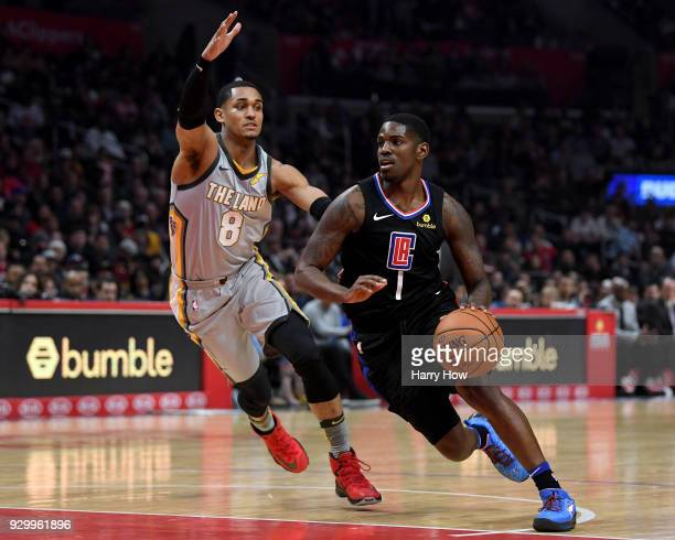 Jawun Evans of the LA Clippers drives past Jordan Clarkson of the Cleveland Cavaliers during a 116102 Clipper win at Staples Center on March 9 2018...