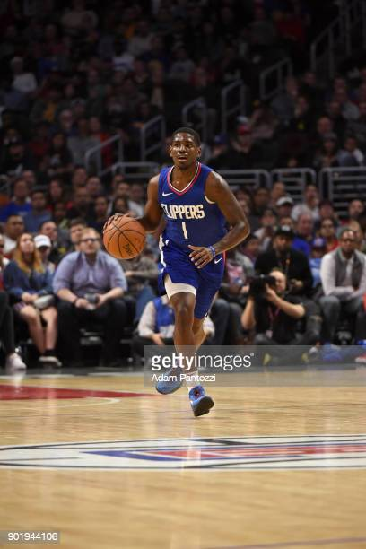 Jawun Evans of the LA Clippers handles the ball against the Golden State Warriors on January 6 2018 at STAPLES Center in Los Angeles California NOTE...