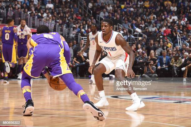 Jawun Evans of the LA Clippers plays defense against the Los Angeles Lakers on November 27 2017 at STAPLES Center in Los Angeles California NOTE TO...