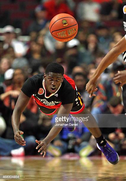 Jawun Evans of the East team goes airbourne after saving the ball and passing it during the 2015 McDonalds's All American Game at the United Center...