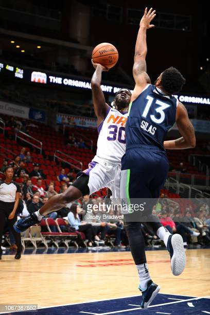 Jawun Evans of the Northern Arizona Suns shoots over Xavier Silas of the Iowa Wolves in an NBA GLeague game on December 1 2018 at the Wells Fargo...