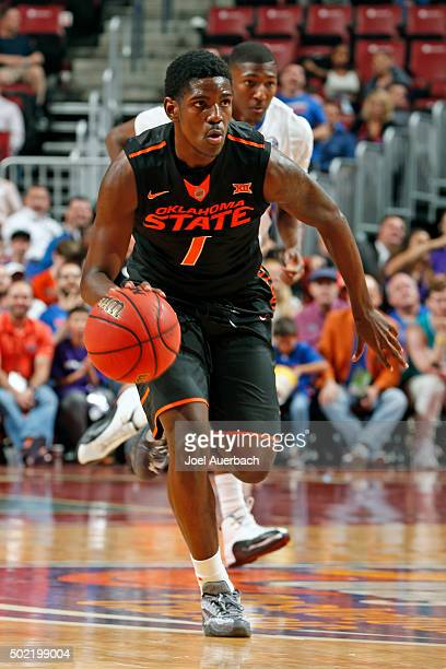 Jawun Evans of the Oklahoma State Cowboys brings the ball up court against the Florida Gators during the MetroPCS Orange Bowl Basketball Classic on...