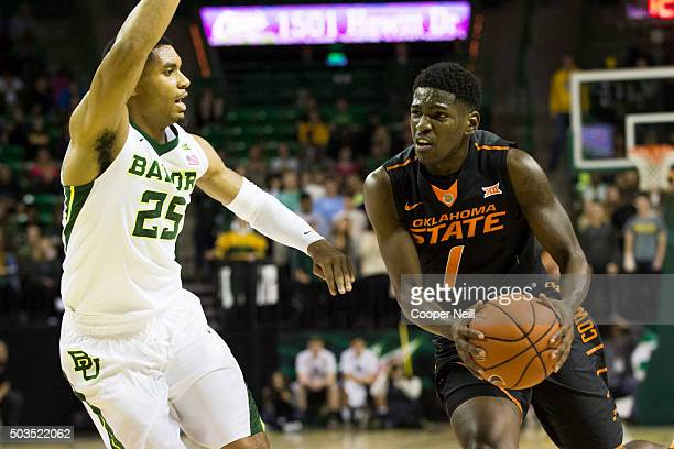 Jawun Evans of the Oklahoma State Cowboys drives to the basket against Al Freeman of the Baylor Bears on January 5 2016 at the Ferrell Center in Waco...