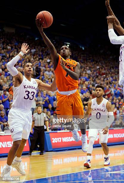 Jawun Evans of the Oklahoma State Cowboys drives toward the basket during the game against the Kansas Jayhawks at Allen Fieldhouse on January 14 2017...