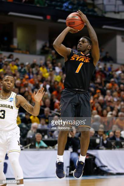Jawun Evans of the Oklahoma State Cowboys shoots the ball against the Michigan Wolverines during the first round of the 2017 NCAA Men's Basketball...