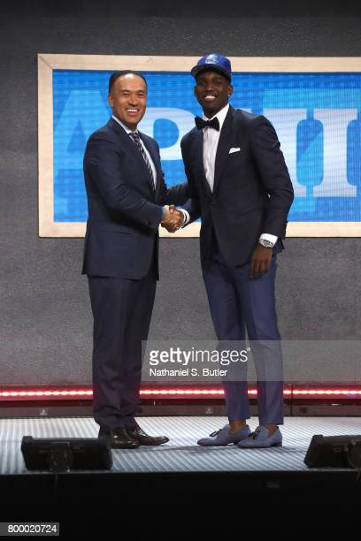 Jawun Evans shakes hands with Deputy Commissioner Mark Tatum after being selected thirty ninth overall by the Philadelphia 76ers during the 2017 NBA...