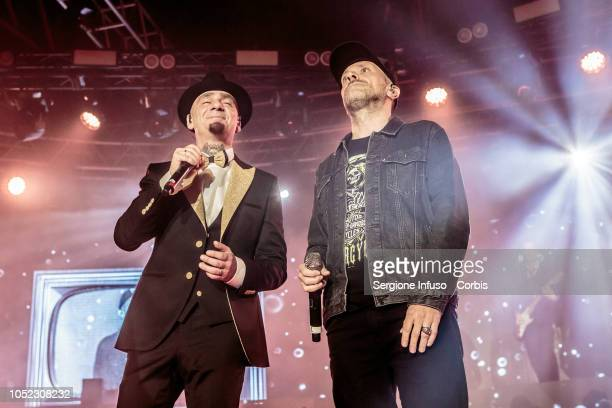 Ax and Max Pezzali perform on stage at Fabrique Club on October 16 2018 in Milan Italy