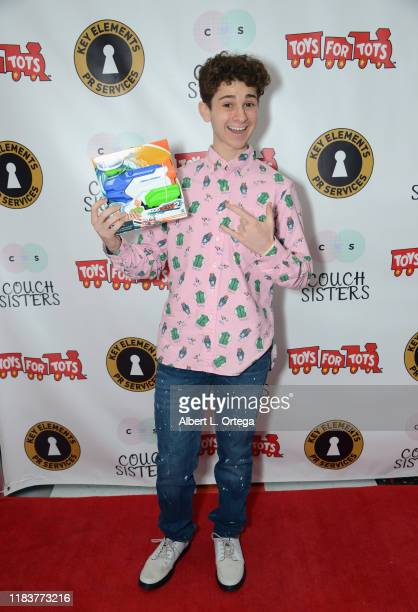 Jax Malcolm attends The Couch Sisters 1st Annual Toys For Tots Toy Drive held onNovember 20 2019 in Glendale California