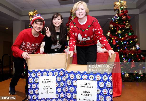 Jax Malcolm Chloe Noelle and Connor Dean attend the Holiday Tour of the Hollywood Museum at The Hollywood Museum on December 7 2017 in Hollywood...