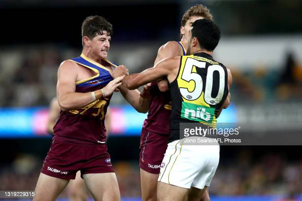 Jaxon Prior and Deven Robertson of the Lions clash with Marlion Pickett of the Tigers during the round 10 AFL match between the Brisbane Lions and...