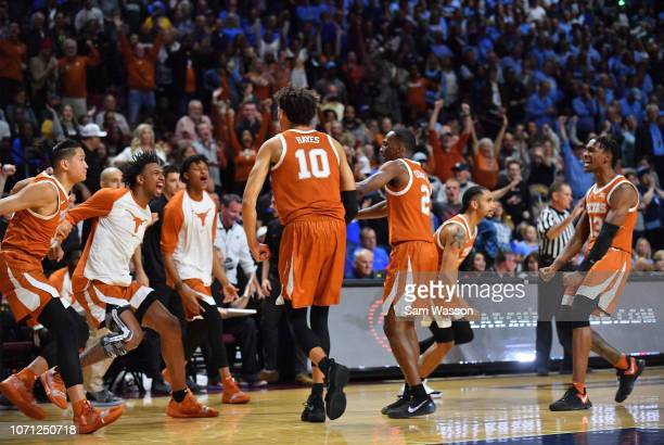 Jaxson Hayes Matt Coleman III Jase Febres and their teammates celebrate after defeating the North Carolina Tar Heels 9289 during the 2018 Continental...