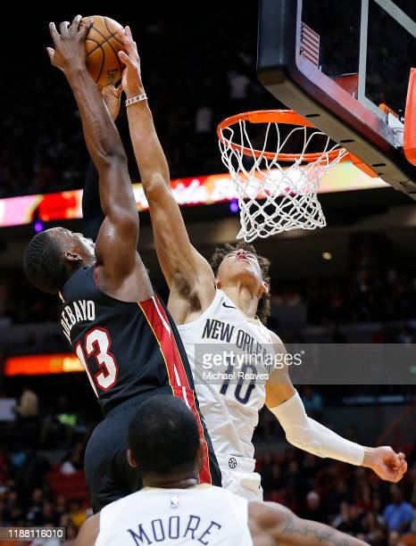 Jaxson Hayes of the New Orleans Pelicans blocks a shot by Bam Adebayo of the Miami Heat during the second half at American Airlines Arena on November...