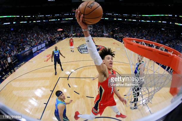 Jaxson Hayes of the New Orleans Pelicans dunks as Seth Curry of the Dallas Mavericks defends during the second half at the Smoothie King Center on...