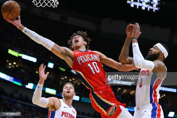 Jaxson Hayes of the New Orleans Pelicans grabs a rebound against Markieff Morris and Blake Griffin of the Detroit Pistons during the first half at...