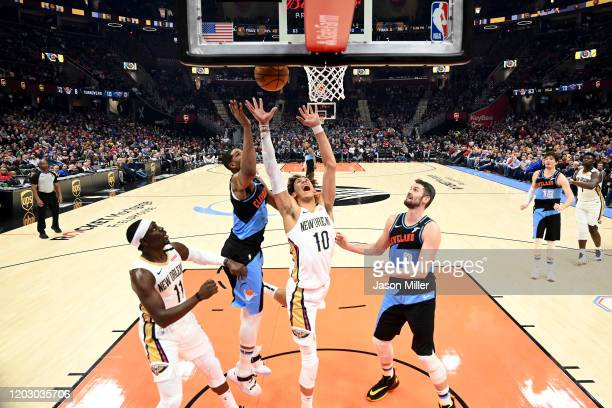 Jaxson Hayes of the New Orleans Pelicans shoots over Tristan Thompson and Kevin Love of the Cleveland Cavaliers during the second half at Rocket...