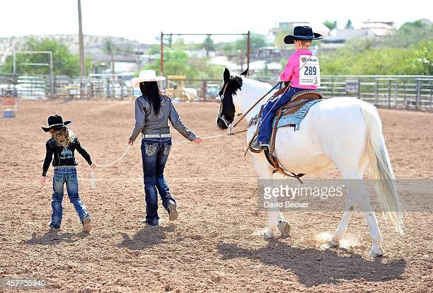 Jaxson Kidd is lead by 2014 Little Britches Princess Josie Linberg and 2014 Miss Nevada High School Rodeo Jenni Mann as his wish is granted from the...