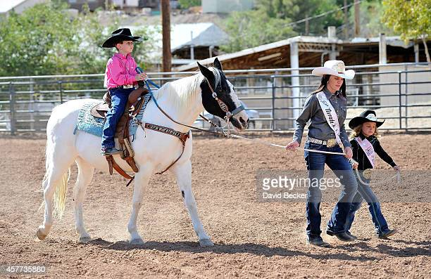 Jaxson Kidd is lead by 2014 Miss Nevada High School Rodeo Jenni Mann and 2014 Little Britches Princess Josie Linberg as his wish is granted from the...