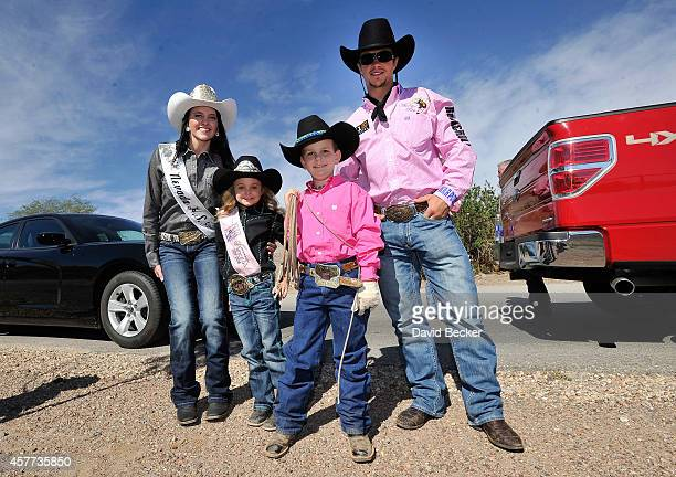 Jaxson Kidd poses with 2014 Miss Nevada High School Rodeo Jenni Mann 2014 Little Britches Princess Josie Linberg and bull rider Cody Nance as Kidd's...