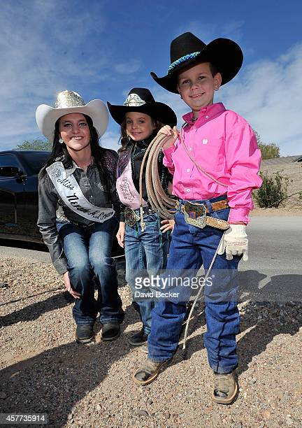 Jaxson Kidd poses with 2014 Miss Nevada High School Rodeo Jenni Mann and 2014 Little Britches Princess Josie Linberg as his wish is granted from the...