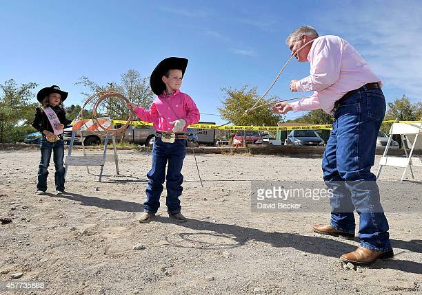 Jaxson Kidd ropes his father Patrick Kidd as 2014 Little Britches Princess Josie Linberg looks on as the younger Kidd's wish is granted from the...