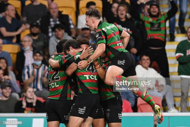Jaxson Paulo of the Rabbitohs celebrates with team mates after scoring a try during the NRL Preliminary Final match between the South Sydney...