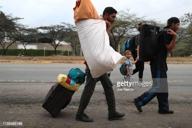 Jaxson Salazar Daniel Guzman Daniela Guzman and Antonio Cardoza all of whom are from Barcelona Venezuela are seen after crossing the border and are...