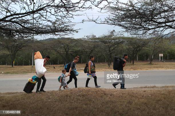 Jaxson Salazar Daniel Guzman Daniela Guzman Carolina Gonzalez and Antonio Cardoza all of whom are from Barcelona Venezuela are seen after crossing...