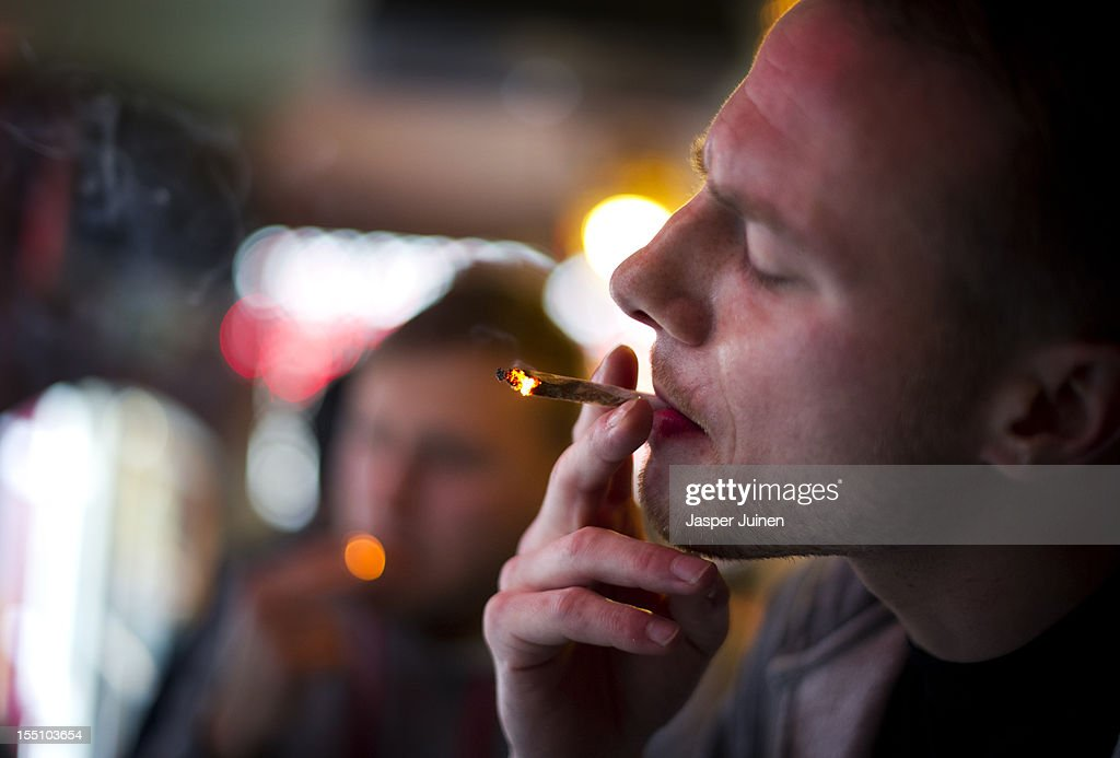 Jay, 29 years old from London, smokes cannabis in a coffee shop on November 1, 2012 in the center of Amsterdam, Netherlands. Coffee shops in the Dutch captial will remain open to tourists after its mayor, Eberhard van der Laan, decided that tourists will not be banned from the 220 coffee shops in Amsterdam where marijuana and hashish are openly sold and consumed. The decision came after the new government of the Netherlands stated that it would be up to local authorities to decide whether or not to impose a ban on cannabis.