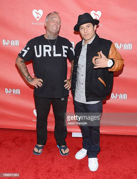 Jay Adams and Christian Hosoi attend the 9th Annual MusiCares MAP Fund Benefit Concert at Club Nokia on May 30 2013 in Los Angeles California