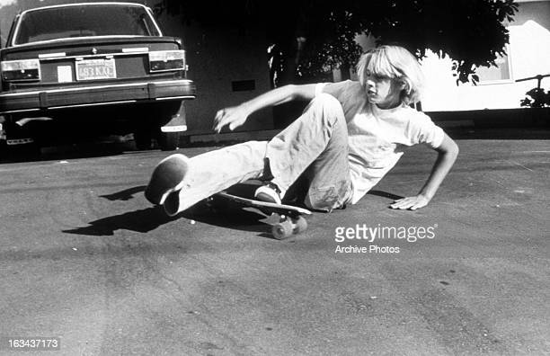 Jay Adams falls from skate board in a scene from the film 'Dogtown And ZBoys' 2001