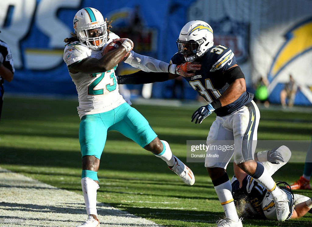 Jay Ajaya #23 of the Miami Dolphins runs the ball against the San Diego Chargers during the second half at Qualcomm Stadium on November 13, 2016 in San Diego, California.